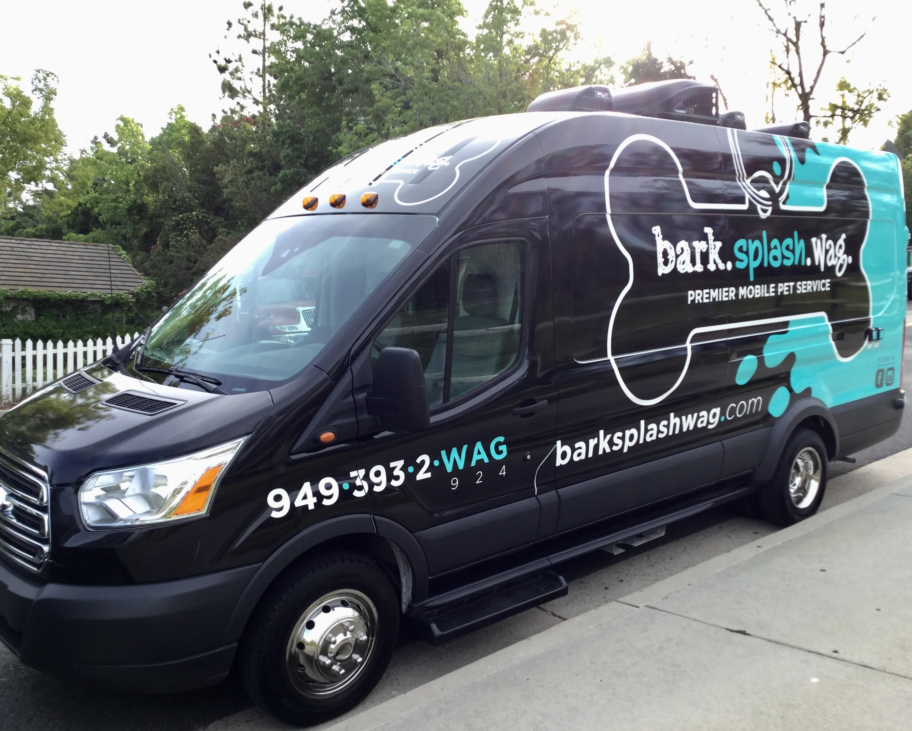 Bark.Splash.Wag. Van front side view Outside