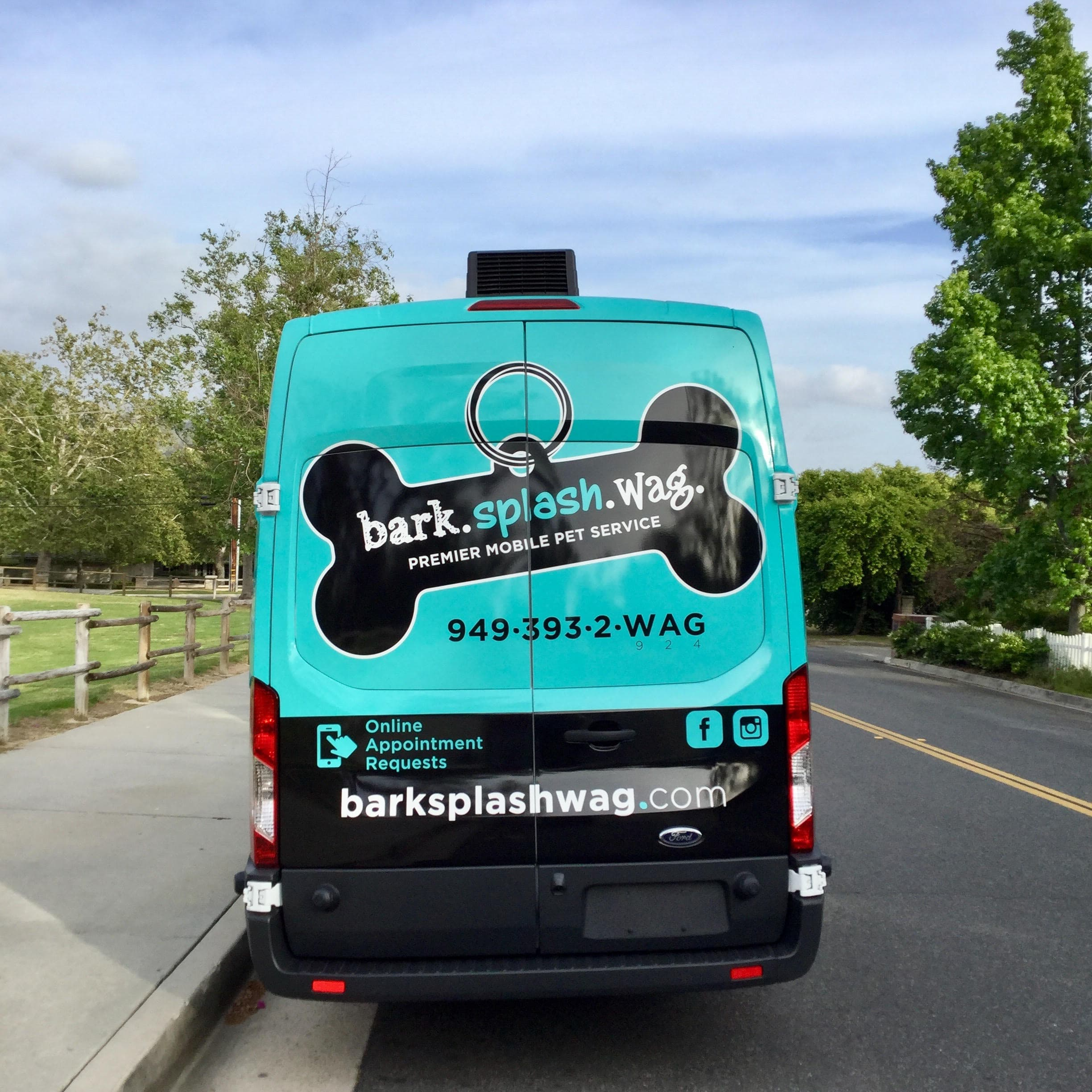 Bark.Splash.Wag. Van back view Outside